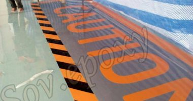 งานตีเส้น ลูกศร เครื่องหมายจราจร และ ตัวอักษร